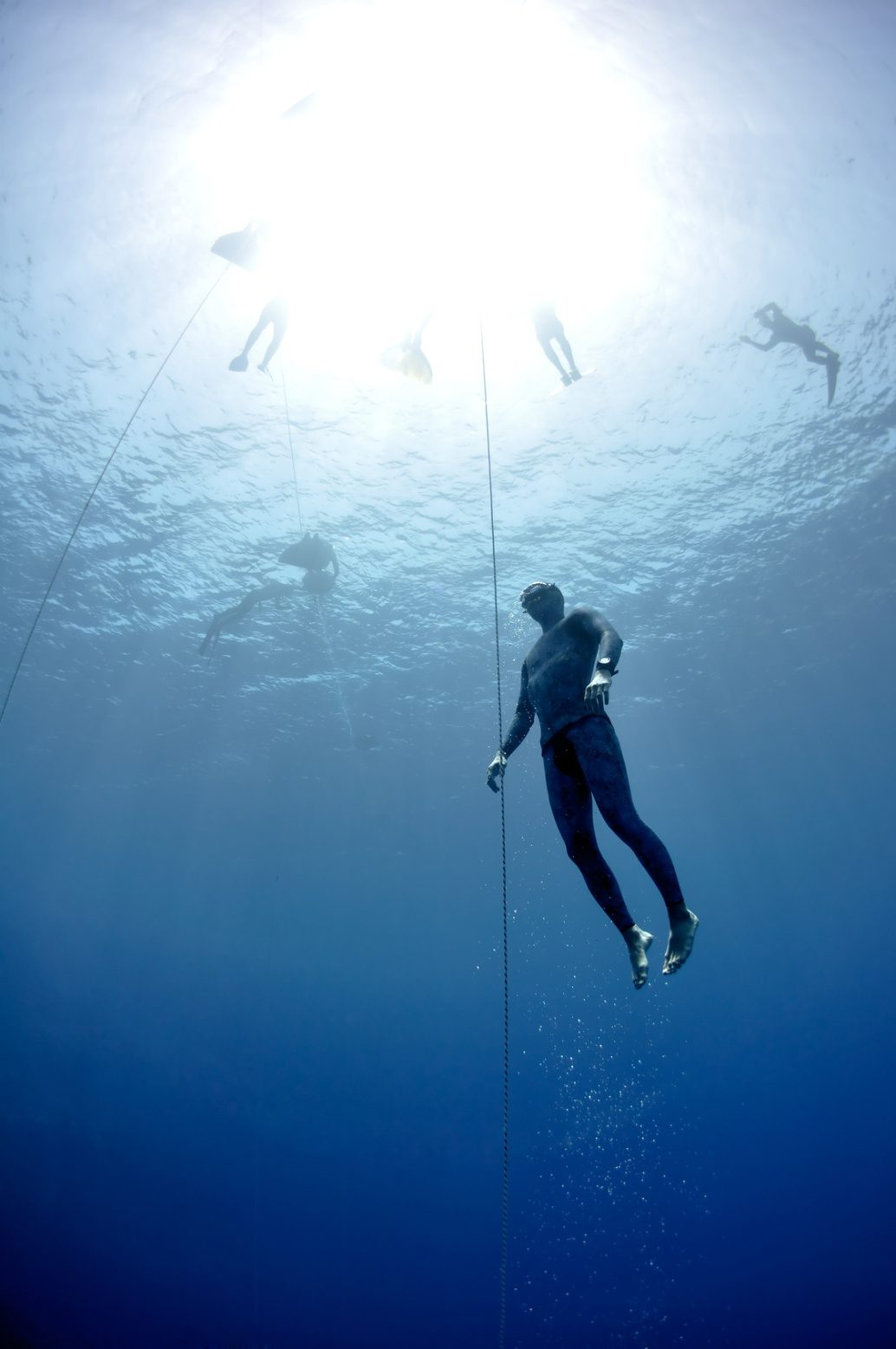 Freediver makes preparation dive near the safety line by breaststroke. Picture shows a part of freediving training session in Blue Hole, Dahab, Egypt